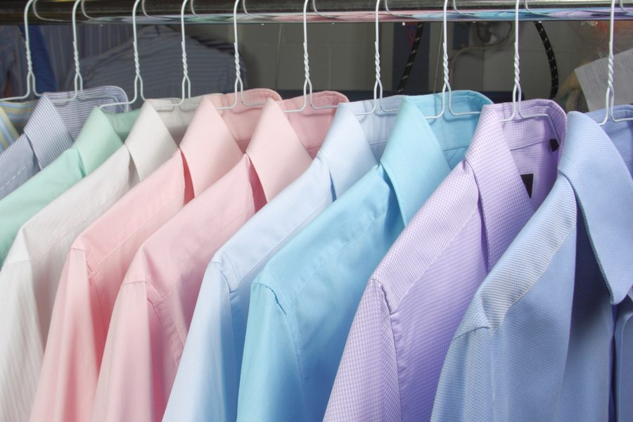 Shirts hanging up after dry cleaning